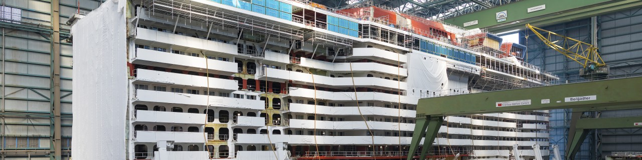 part of cruise ship in shipyard