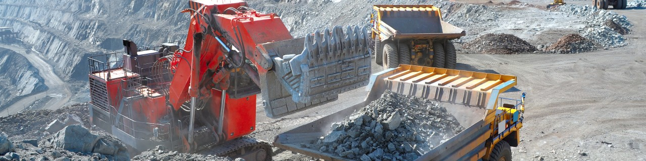 Excavator extracting iron ore