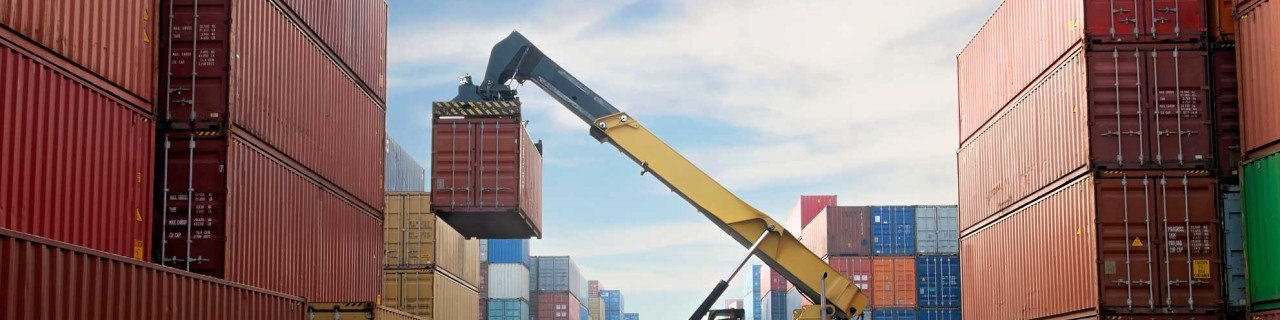 Crane lifting up container in a port